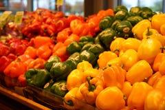 Paprikas amarillos, rojos, y verdes Fotografía de archivo libre de regalías