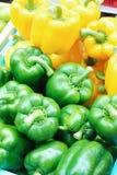 Paprikas amarillos y verdes Imagen de archivo libre de regalías