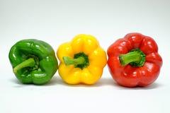 Paprikas Amarillos y verdes rojos Imagenes de archivo