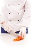 Paprikas de coupe de chef Photos stock