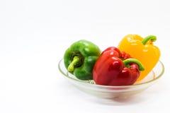 Paprikas del multicolor en el fondo blanco Fotografía de archivo