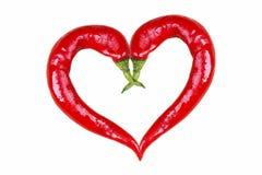 Paprikas in der Liebesform Stockbilder