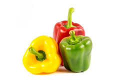Paprikas doux rouges, verts et jaunes Photo libre de droits