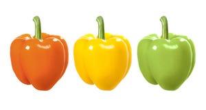 Paprikas rojos, amarillos y verdes en un blanco Imagenes de archivo