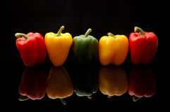 Paprikas rojos, verdes y amarillos Imagen de archivo libre de regalías