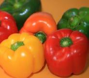 Paprikas, rouge coloré, jaune, vert et orange Images stock