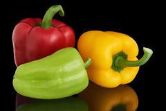 Paprikas rouges, jaunes et verts Photographie stock