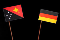Papua-Neu-Guinea Flagge mit deutscher Flagge auf Schwarzem Stockfoto