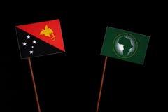 Papua-Neu-Guinea Flagge mit Flagge der Afrikanischen Union auf Schwarzem Stockbilder