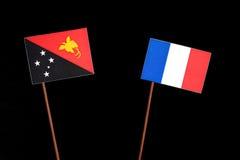 Papua-Neu-Guinea Flagge mit französischer Flagge auf Schwarzem Stockfoto
