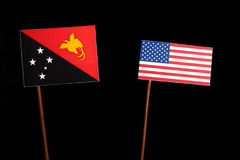 Papua-Neu-Guinea Flagge mit USA-Flagge auf Schwarzem Lizenzfreie Stockbilder