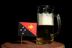 Papua New Guinea flag with beer mug  on black Royalty Free Stock Photos