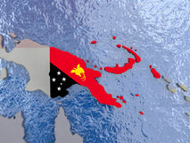 Papua New Guinea with flag on globe Stock Photography