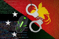 Papua New Guinea flag and handcuffed computer mouse. Combating computer crime, hackers and piracy. Papua New Guinea flag and handcuffed modern backlit computer stock image