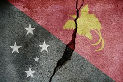 Papua New Guinea FLAG PAINTED ON CRACKED WALL cool. Papua New Guinea FLAG PAINTED ON CRACKED WALL stock photo