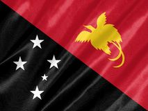 Papua New Guinea Flag. With waving on satin texture royalty free stock images