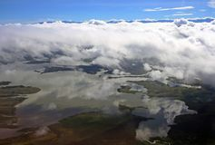 Papua New Guinea Lake. Clouds fill the blue sky in over Yonki lake in Papua New Guinea lake stock photo