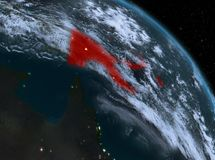 Papua New Guinea at night from orbit. Night above Papua New Guinea highlighted in red on model of planet Earth in space. 3D illustration. Elements of this image Stock Image