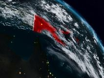 Papua New Guinea at night. Papua New Guinea from space at night with visible country borders. 3D illustration. Elements of this image furnished by NASA stock illustration