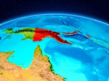 Papua New Guinea from orbit. Satellite view of Papua New Guinea highlighted in red on planet Earth. 3D illustration. Elements of this image furnished by NASA Royalty Free Stock Images