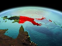 Papua New Guinea on planet Earth in space. Morning above Papua New Guinea highlighted in red on model of planet Earth in space. 3D illustration. Elements of this Stock Image