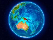 Papua New Guinea on Earth. Papua New Guinea in red from Earth's orbit. 3D illustration. Elements of this image furnished by NASA Royalty Free Stock Photo