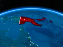 Papua New Guinea from space at night. Orbit view of Papua New Guinea highlighted in red with visible borderlines and city lights on planet Earth at night. 3D Royalty Free Stock Photography