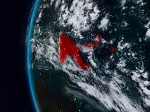 Papua New Guinea from space during night. Papua New Guinea at night with visible country borders. 3D illustration. Elements of this image furnished by NASA stock illustration