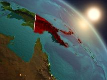 Papua New Guinea from space during sunrise. Sunset above Papua New Guinea from space on planet Earth with visible country borders. 3D illustration. Elements of Stock Photos