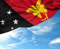 Papua New Guinea waving flag on a beautiful day Royalty Free Stock Images