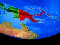 Papua Nya Guinea från utrymme på jord vektor illustrationer