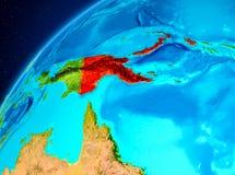 Papua Nya Guinea på jord från utrymme Arkivbilder