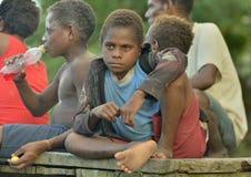 Papuan children outdoors. Asmat people village. Stock Images