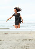 Papuan girl jumping on beach Stock Images