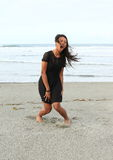 Papuan girl shouting on beach Stock Image
