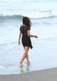 Papuan girl walking in sea Royalty Free Stock Photos