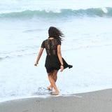 Papuan girl walking in sea Stock Photos