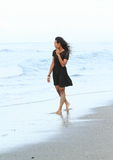 Papuan girl walking in sea Stock Image