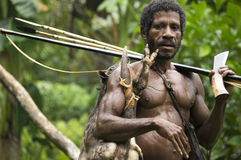 Papuan Hunter. Local hunter from West Papua, Indonesia with a recently caught wallaby Stock Photography