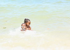 Papuan kids playing in sea Royalty Free Stock Photography