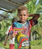 Papuan little boy with notebook Royalty Free Stock Photo