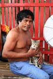Papuan man with cat Stock Image