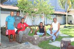 Papuan men posing in Sorong Stock Photo