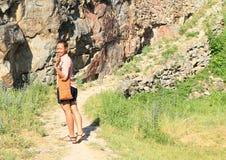 Smiling girl walking on castle Girls Stone royalty free stock images