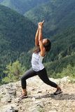 Girl exercising yoga in front of forest hills in Slovak Paradise Royalty Free Stock Photo