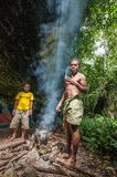 Papuans of the island New Guinea made fire to cook food. People from a tribe of Jafi Stock Photos