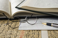 Papyrus and Books of Hieroglyphs Stock Images
