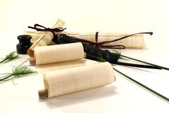 Papyrus rolls with inkwell and pen Royalty Free Stock Photos
