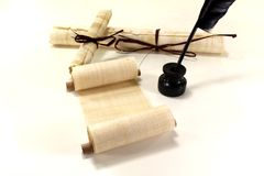 Papyrus rolls with inkwell and quill Stock Image