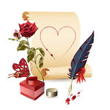 Papyrus, rose, ink pot and a feather Royalty Free Stock Photography
